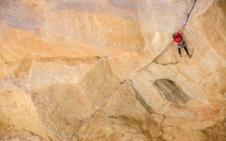 Hannes Puman & Tom Randall climbing an 8b+ roof crack.